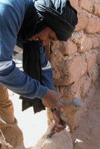 Mohammed showing how he dug the well